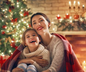Mother and daughter sitting together on Christmas Eve Stock Photo