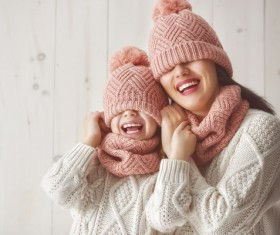 Mother and daughter wearing knit sweaters Stock Photo 01