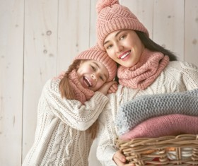 Mother and daughter wearing knit sweaters Stock Photo 02