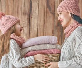 Mother and daughter wearing knit sweaters Stock Photo 03