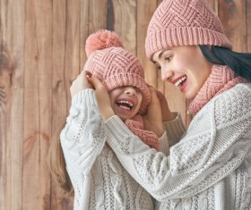 Mother and daughter wearing knit sweaters Stock Photo 04