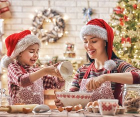 Mother and daughter who make Christmas food in the kitchen Stock Photo 01