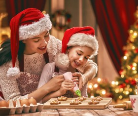 Mother and daughter who make Christmas food in the kitchen Stock Photo 02