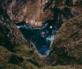 Mountain cliff and beach scene Stock Photo