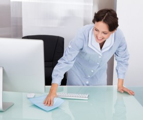 Nurse cleaning the desk Stock Photo