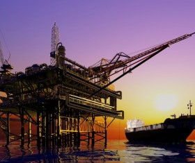 Offshore production platform and tankers Stock Photo