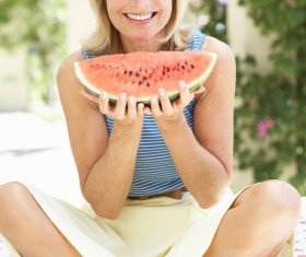 Older people eat watermelon Stock Photo