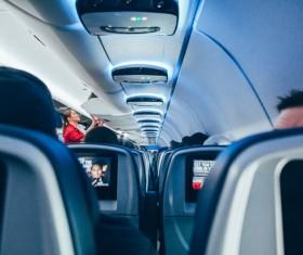 Passengers on modern airplane Stock Photo