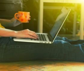 People using laptop drinking coffee Stock Photo 01