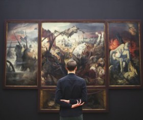 People visiting the exhibition of paintings Stock Photo
