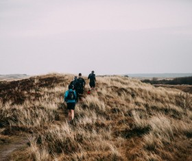 People walking on wild grassland Stock Photo