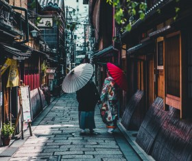 People wearing Japanese traditional kimono walk in the alley Stock Photo