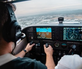 Pilot monitoring helicopter in cabin Stock Photo