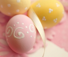 Pink and yellow Easter eggs with ribbons Stock Photo