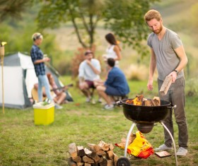 Point camping bonfire man Stock Photo