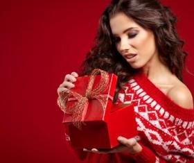 Pretty woman opening Christmas gift Stock Photo