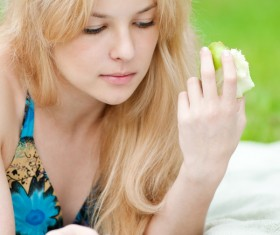 Read Book Girl eating apple Stock Photo