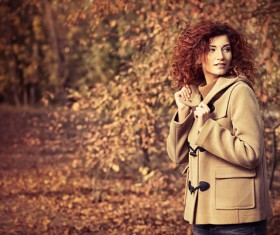 Red haired girl walking in the autumn park Stock Photo 01