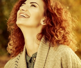 Red haired girl walking in the autumn park Stock Photo 04