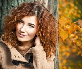 Red haired girl walking in the autumn park Stock Photo 05
