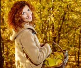 Red haired girl walking in the autumn park Stock Photo 06