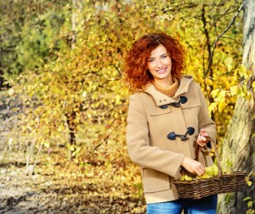 Red haired girl walking in the autumn park Stock Photo 07