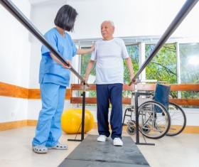 Rehabilitation instructor to guide the elderly exercise Stock Photo