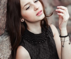 Rely on the wall beautiful young lady Stock Photo 01