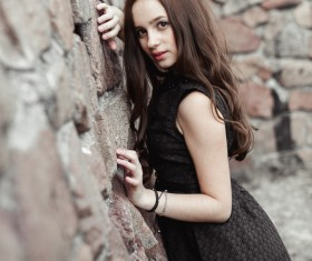 Rely on the wall beautiful young lady Stock Photo 02