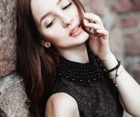 Rely on the wall beautiful young lady Stock Photo 04