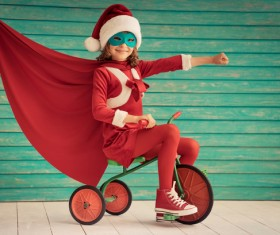 Riding tricycle happy little girl Stock Photo
