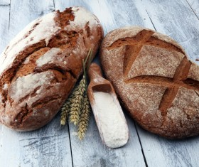 Rye bread and flour on the table Stock Photo