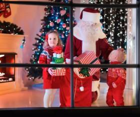 Santa Claus gives children presents Stock Photo