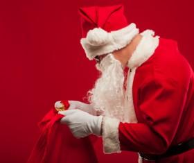 Santa Claus holding Christmas baggage Stock Photo