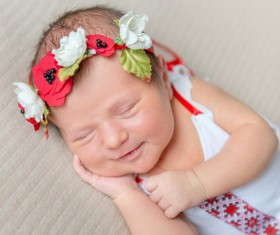 Sleeping baby smiling Stock Photo 01