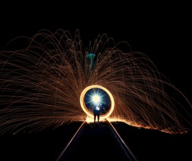 Sparkling bright explosion firework at night Stock Photo