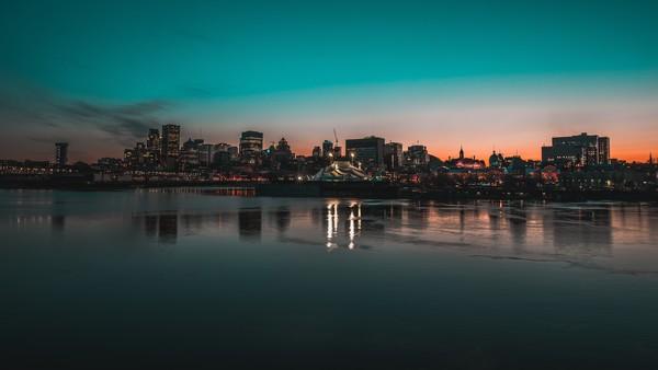 Sparkling modern city on riverside Stock Photo