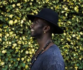 Stylish black man posing with hat Stock Photo