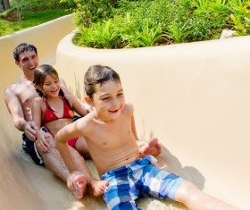 Take the kids play Water slide Father Stock Photo