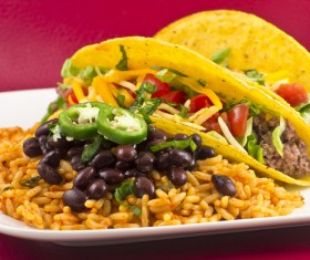 Tasty snacks tortillas and beans rice Stock Photo