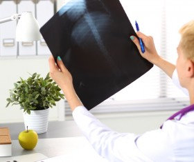 The doctor looks at the patient X-ray Stock Photo 02