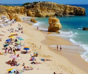 Tourist relaxing on beautiful beach Stock Photo
