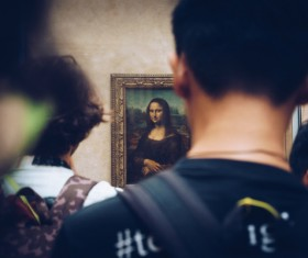 Tourists watch famous paintings in the gallery Stock Photo