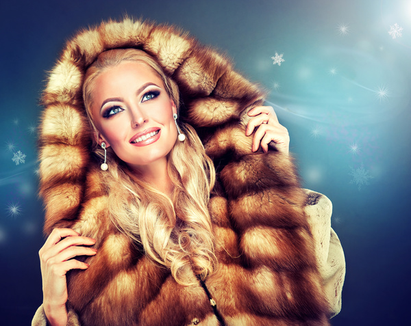 Wearing a fur coat woman Stock Photo