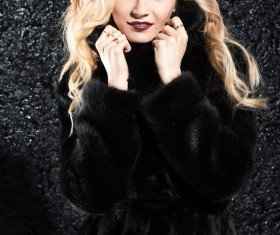 Wearing black mink coat beautiful fashionable blonde Stock Photo 01