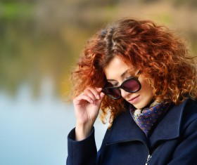 Wearing sunglasses red haired woman Stock Photo 01