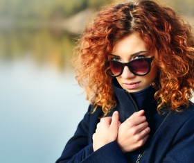 Wearing sunglasses red haired woman Stock Photo 03