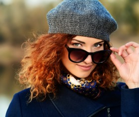 Wearing sunglasses red haired woman Stock Photo 04