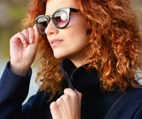 Wearing sunglasses red haired woman Stock Photo 05