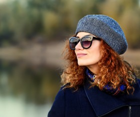 Wearing sunglasses red haired woman Stock Photo 06